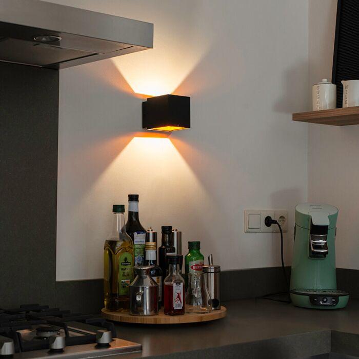Design-wandlamp-zwart/goud-incl.-LED---Caja